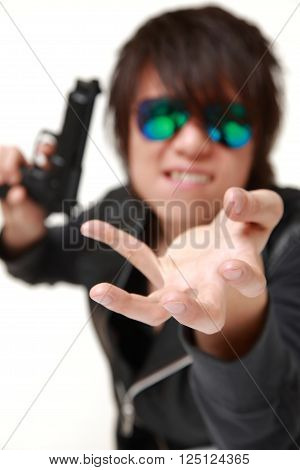 portrait of man with a handgun on white background