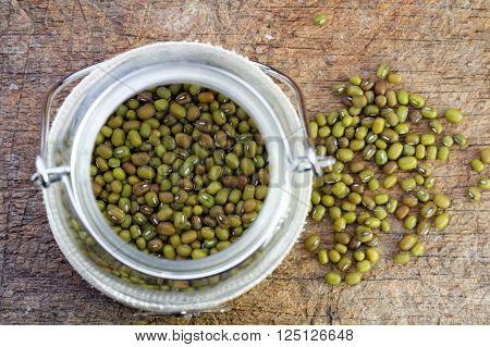 Mung bean in glass jar on wooden table