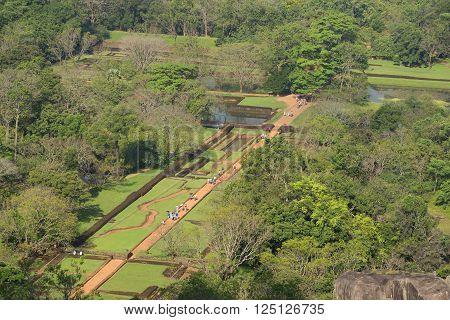 SIGIRIYA, SRI LANKA - MARCH 16, 2015: Aerial view of the ruins of the palace of Sigiriya, Water Garden. Historical landmark of the city Sigiriya, Sri Lanka