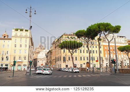 Rome, Italy - August 8, 2015: Largo di Torre Argentina, square in Rome. Street view with walking ordinary people and cars