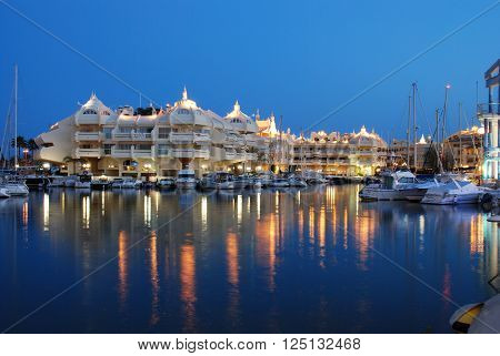 BENALMADENA, SPAIN - JUNE 29, 2008 - Boats and apartments in the marina at dusk Benalmadena Malaga Province Andalusia Spain Western Europe, June 29, 2008.