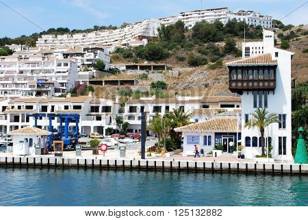 MARINA DEL ESTE, SPAIN - JUNE 10, 2008 - View of the harbour masters office and fuel station with apartments to the rear Marina del Este Malaga Province Andalusia Spain Western Europe, June 10, 2008.