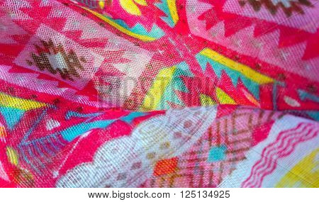 Closeup of fragment fabric texture with bright colorful pattern