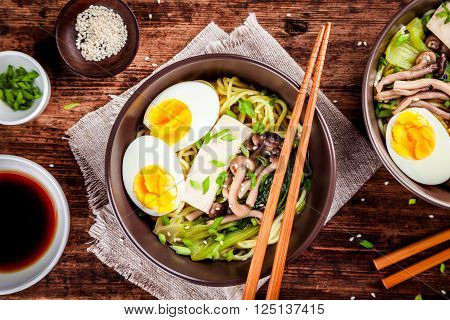 Asian miso ramen noodles with eggs tofu and shimeji mushrooms