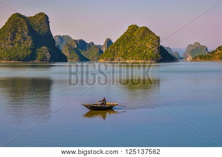 December 18, 2013, Halong Bay, Northern Vietnam. Fisherman on a wicker boat among the islands. ** Note: Visible grain at 100%, best at smaller sizes