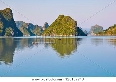 Fishing boats among the islands in Halong Bay.