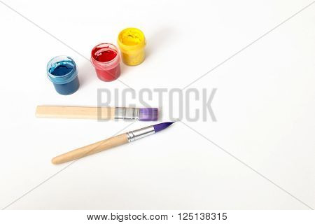Watercolor paint and brushes isolated on white background. Art palette with paints. Colorful paint.