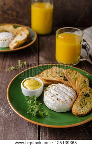 Grilled camembert with toast and juice fresh toasted baquette with herbs and delicious dijon mustard. Beautiful melted cheese.