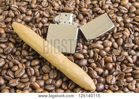cigar and cigarette lighter on the coffee beans background