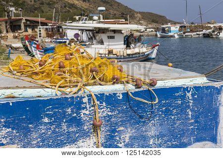 Fishing Nets And Greek Fishing Boats Mooring In Port In Sunrise Light, Crete Island, Greece