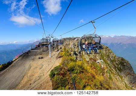 SOCHI, RUSSIA - October 8: People on the cable car in the scenic mountains at the autumn in October 8, 2015, in Sochi, Russia.