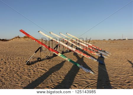 Hang gliders lined up ready for rental
