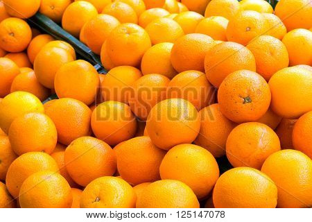 A pile of oranges for sale at a market