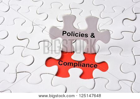 POLICIES & COMPLIANCE with missing puzzle on red background