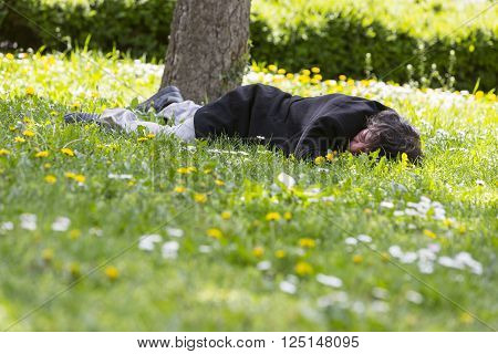 Homeless Sleeping In The Grass