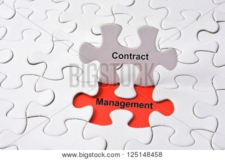 Contract management with missing puzzle on red background