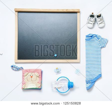 top view fashion trendy look of blackboard and baby stuff, baby fashion concept