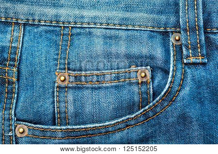 classic blue jeans with pockets sewn in style of sixties