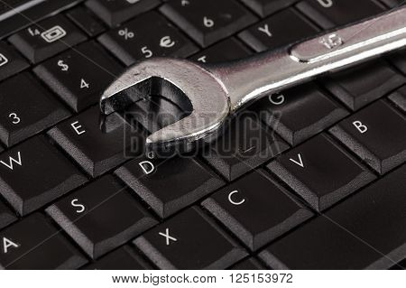Wrench Tool Over A Laptop