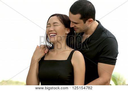 Couple in love enjoying outdoor.Stunning sensual outdoor portrait of interracial happy couple. Asian womanCaucasian man