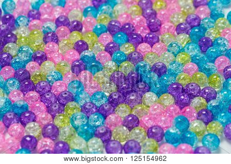Background of rounded bright colorful quartz stones ** Note: Shallow depth of field