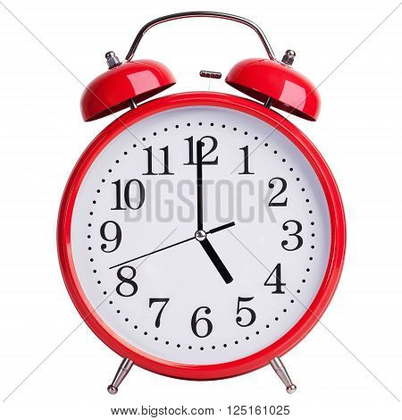 Red alarm clock shows exactly five o'clock