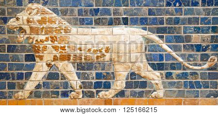 Ancient sumerian tle panel depicting lion