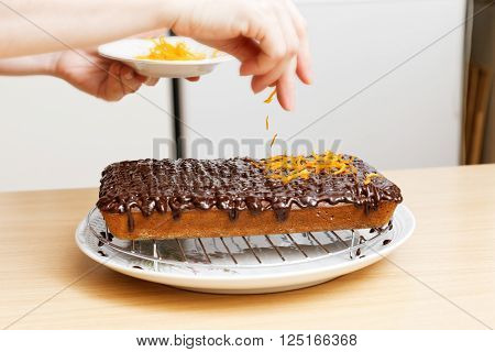Chef Decorate The Cake With Orange Chips