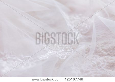 Bride's veil with embroidered elements. Bride's traditional symbolic accessory.