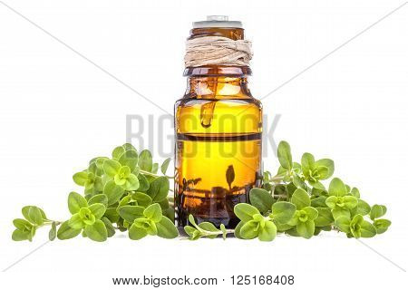 Essential oil made from marjoram on a white background