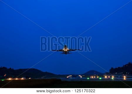 Passenger Airplane take off from runways at night