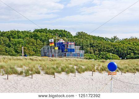 Graal-Mueritz Germany - June 14 2012: Modern lifeguard station of DLRG (Deutsche Lebens-Rettungs-Gesellschaft) at beach in Graal-Mueritz