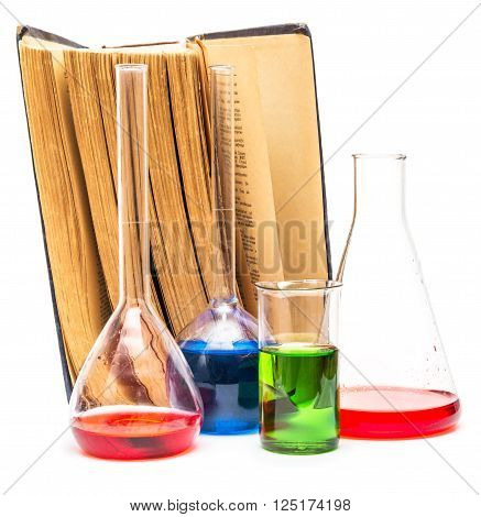 Old books and chemical glassware isolated on white