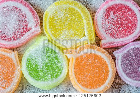 Jelly sweet flavor fruit candy dessert colorful in ceramic bowl on wood background.