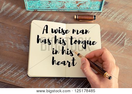 Handwritten quote A wise man has his tongue in his heart