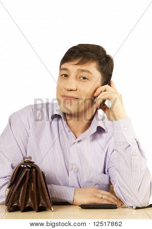 young man speaks on the phone