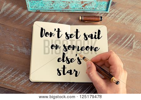 Handwritten quote Don't set sail on someone else's star