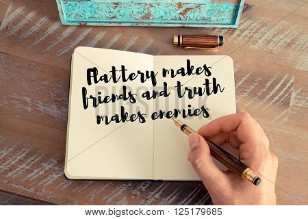 Handwritten quote Flattery makes friends and truth makes enemies as inspirational concept image