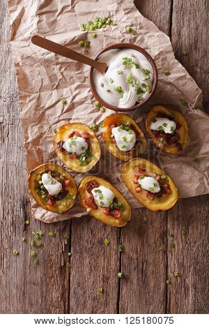 Potato Skins With Cheese, Bacon And Sour Cream On The Table. Vertical Top View