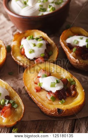 Potatoes Stuffed With Cheese, Bacon And Sour Cream Close-up. Vertical