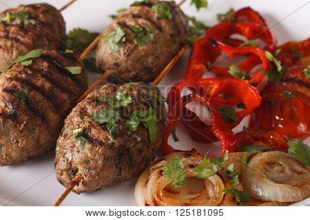 Turkish Kofte Kebab With Grilled Vegetables Close-up. Horizontal