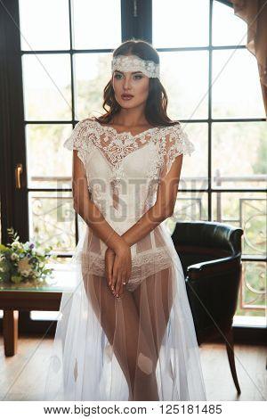 Beautiful sexy girl in boudoir white dress