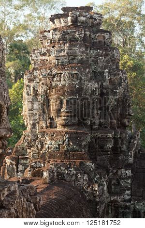 Stone carved faces of Bayon Temple in Angkor Thom Angkor district Siem Reap Cambodia