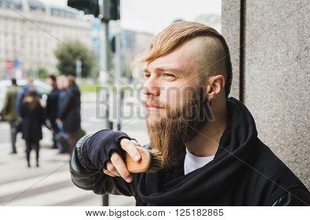 Stylish Man Brushing His Beard