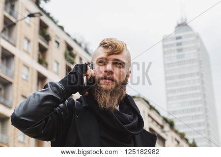 Stylish Bearded Man Talking On Phone