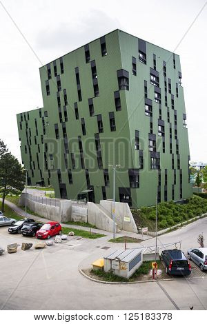 VIENNA, AUSTRIA - MAY 7: Modern residential apartments living house exterior near Gasometers of Vienna on 7 May 2012 in Vienna, Austria.