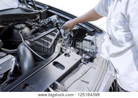 Image of worker hand using a microfiber cloth to clean the car machine and remove dust or dirt
