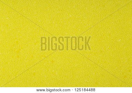 Yellow spongy porou rough macro texture background