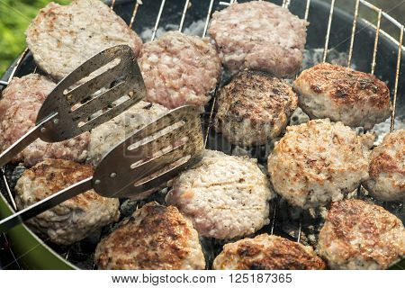 Barbecue In Nature. Baking Meatballs On Charcoal