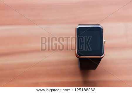 Smart Wrist Watch On The Wooden Background